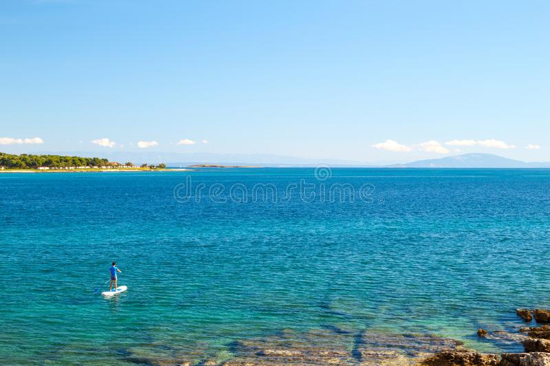 Man on SUP. Stand Up Paddling Panoramic Photo. royalty free stock photography