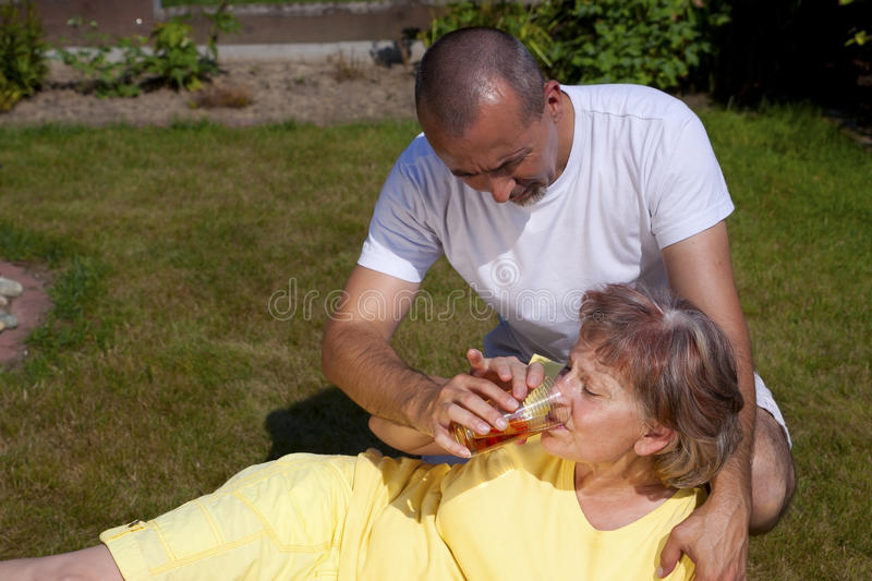 Man Supplied Woman With Heat Stroke Stock Image