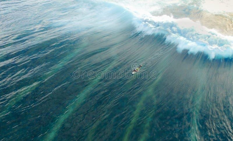 Man on Surfboard Surfing on Wave stock photos
