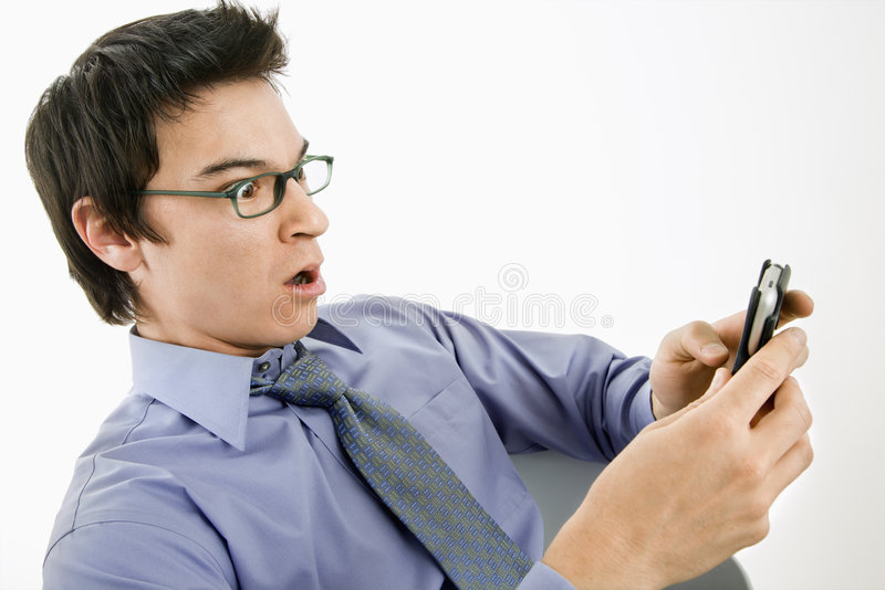 Man surprised at text message. stock image