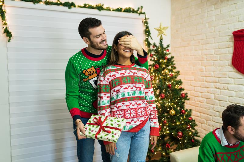 Excited Couple With Surprise Xmas Gift During Celebration At Home stock photography