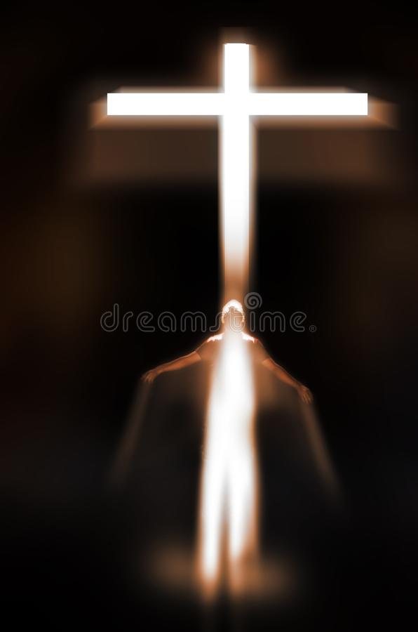 Conversion to Christianity or Christian resurrection. Man surrounded by a white light, opening his arms and looking up towards a bright cross. Concept for royalty free stock image