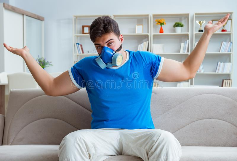 Man sweating excessively smelling bad at home. The man sweating excessively smelling bad at home royalty free stock photography