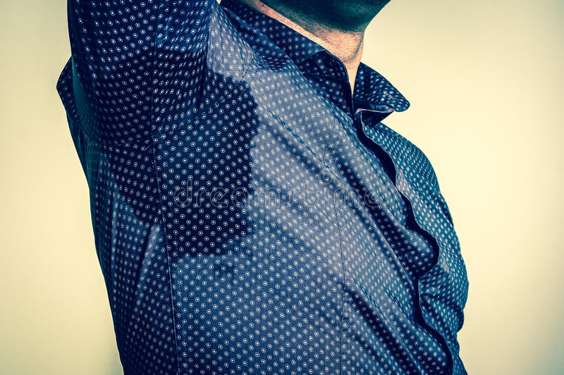 Man with sweating under armpit - retro style. Young man with sweating under armpit - retro style royalty free stock image