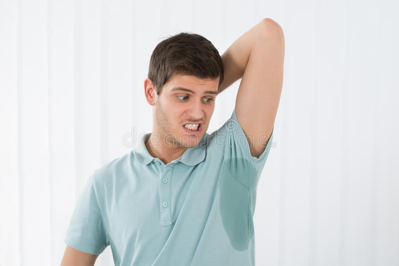 Man Sweating Very Badly Under Armpit stock photo