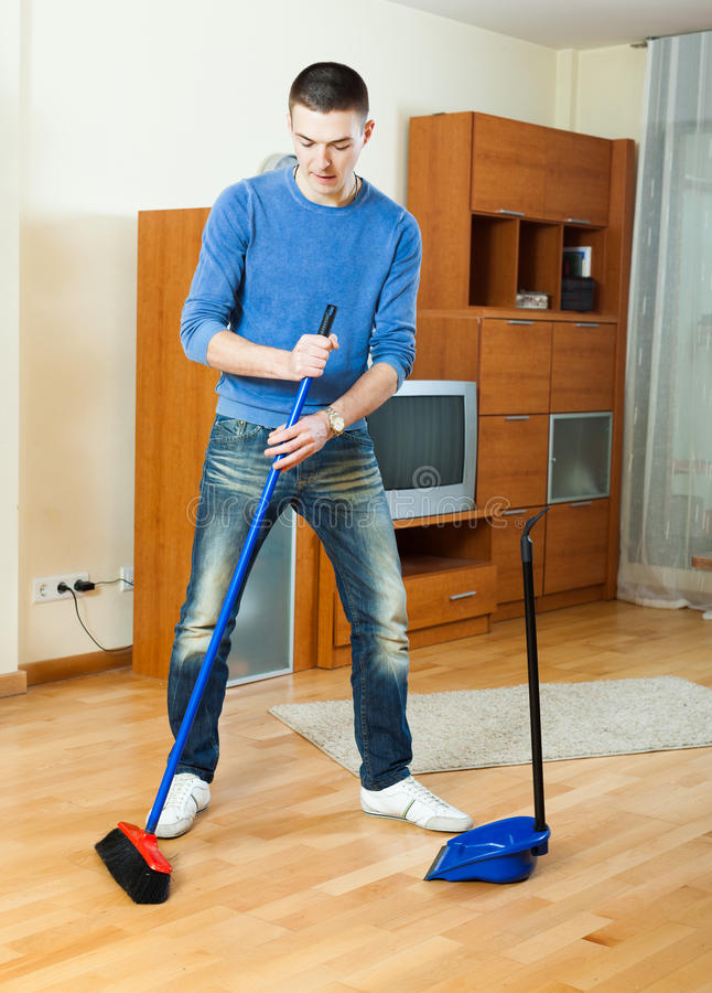 Man Sweeping The Floor At Home Stock Photo Image Of