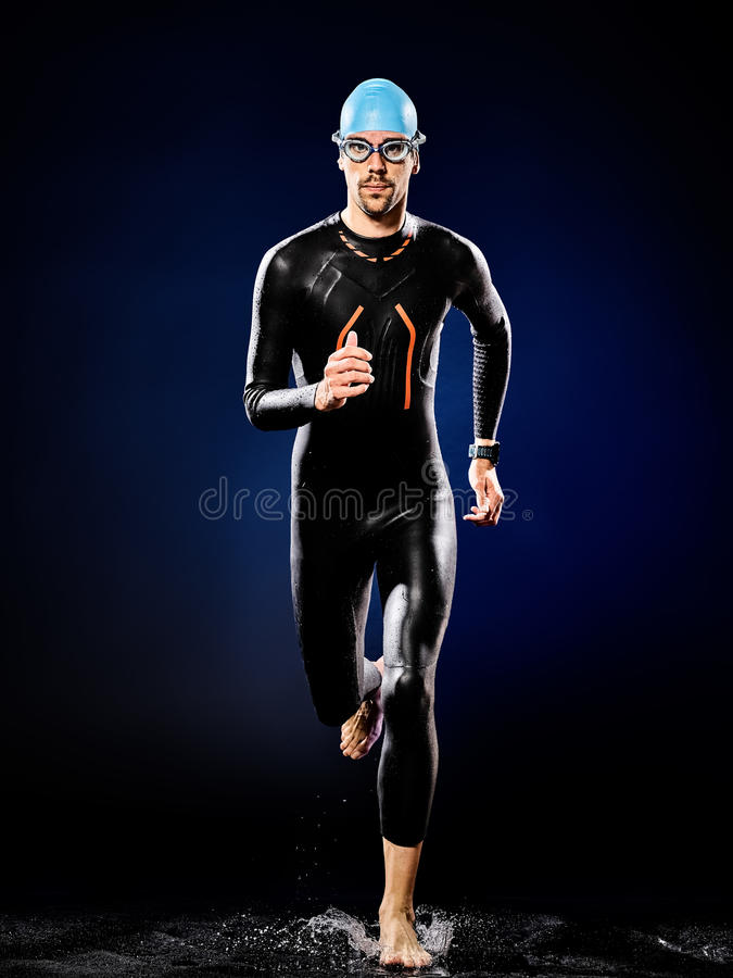 Man swimmer swimming triathlon ironman isolated. One caucasian man triathlon ironman swimmer swimming isolated stock images