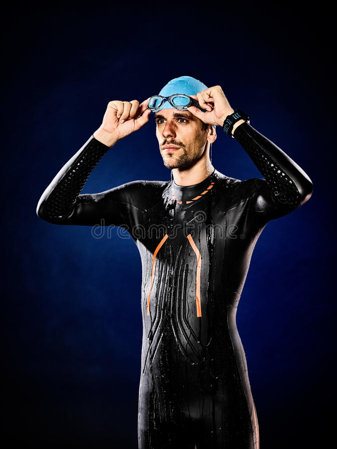 Man swimmer swimming triathlon ironman isolated. One caucasian man triathlon ironman swimmer swimming isolated royalty free stock photo