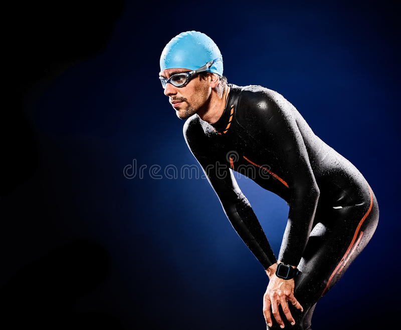Man swimmer swimming triathlon ironman isolated. One caucasian man triathlon ironman swimmer swimming isolated stock image