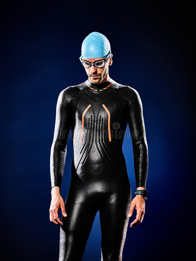 Man swimmer swimming triathlon ironman isolated. One caucasian man triathlon ironman swimmer swimming isolated royalty free stock image