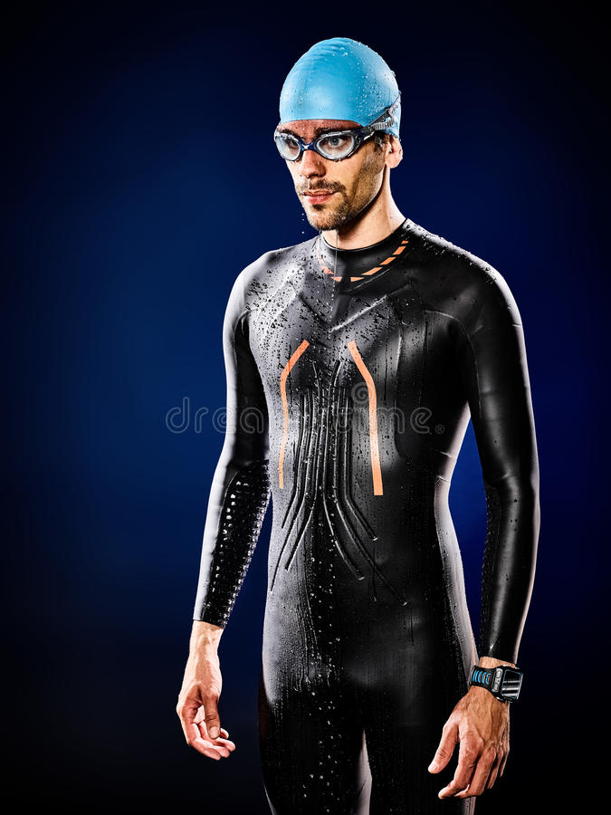 Man swimmer swimming triathlon ironman isolated. One caucasian man triathlon ironman swimmer swimming isolated stock photo