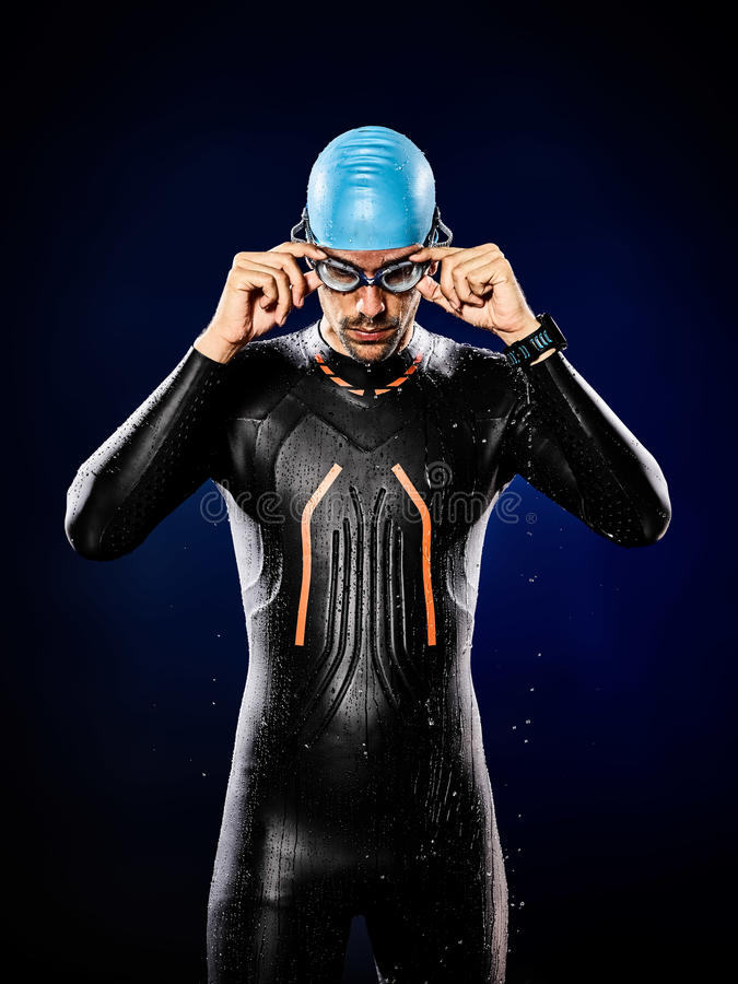 Man swimmer swimming triathlon ironman isolated. One caucasian man triathlon ironman swimmer swimming isolated royalty free stock images
