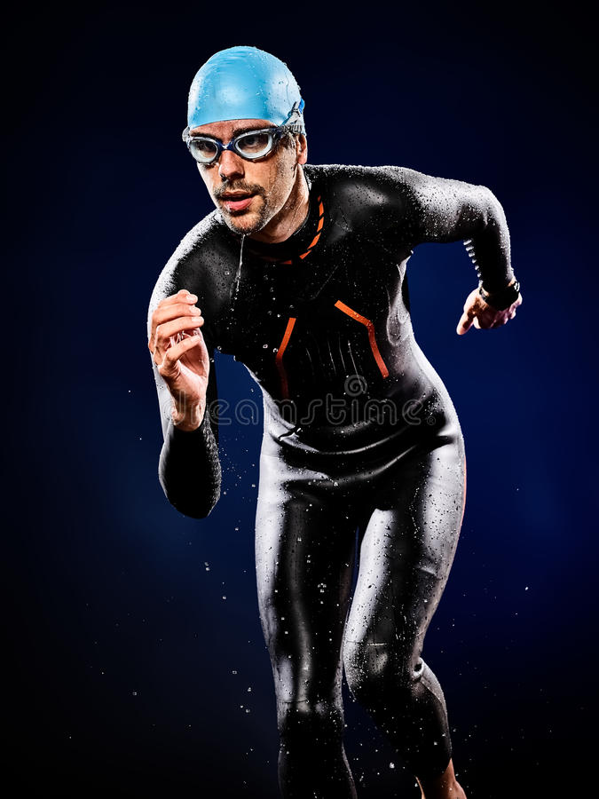 Man swimmer swimming triathlon ironman. One caucasian man triathlon ironman swimmer swimming stock image