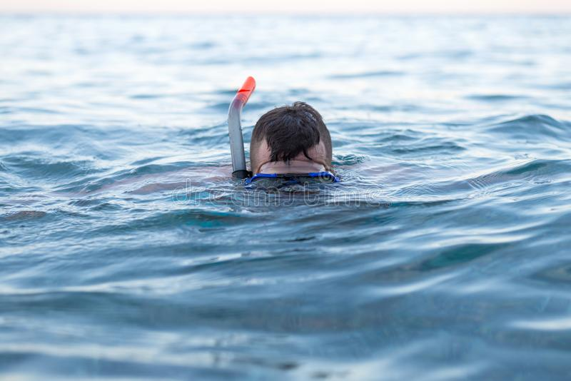Man is swimming in a diving mask. Leisure activities stock photo