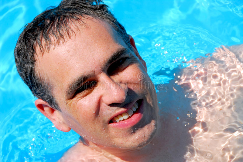 Man swimming pool royalty free stock photography