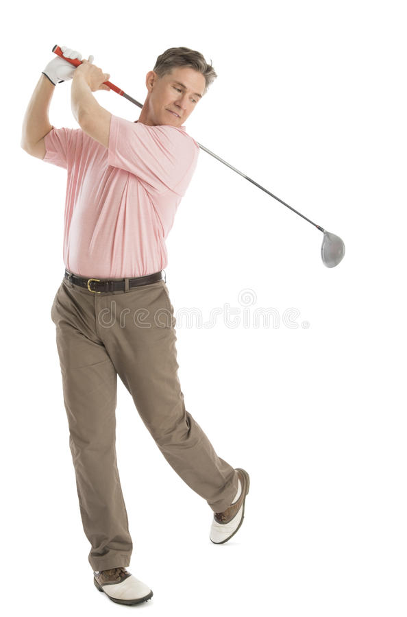 Man Swinging Golf Club Against White Background Royalty -4278
