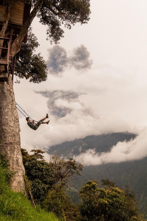 Download Man Swinging On A Swing In