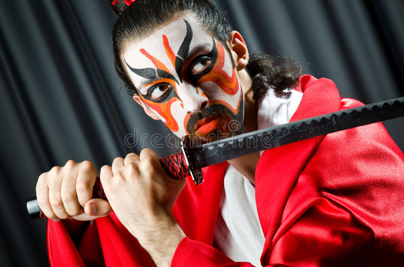 Man with sword. And face mask stock images