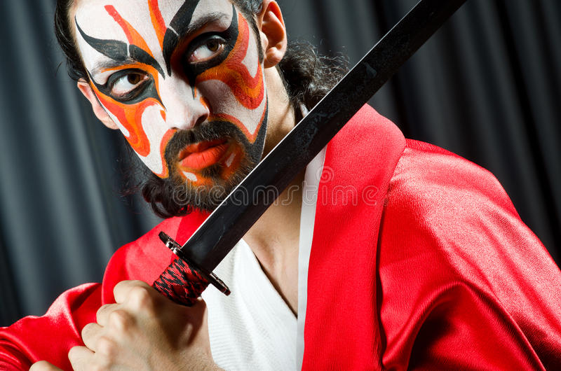 Man with sword. And face mask stock photography
