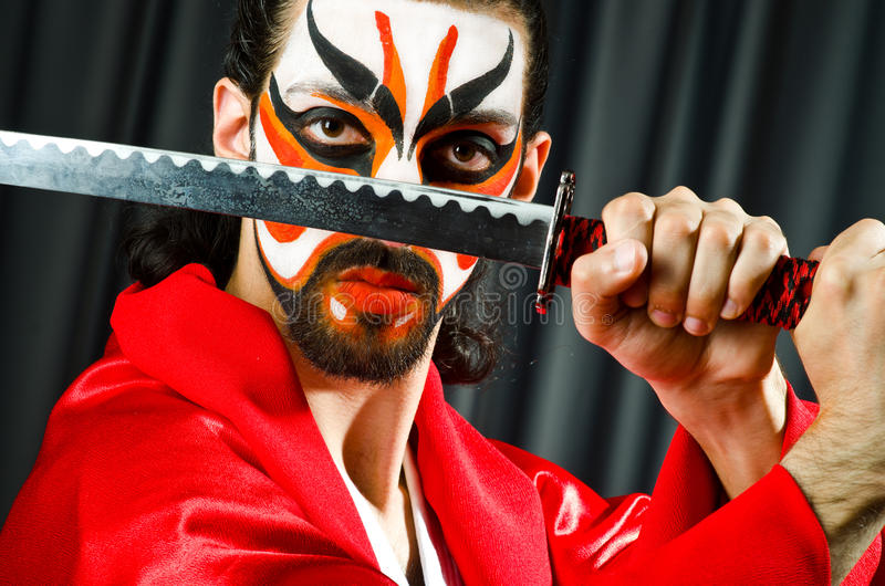 Man with sword. And face mask royalty free stock photo