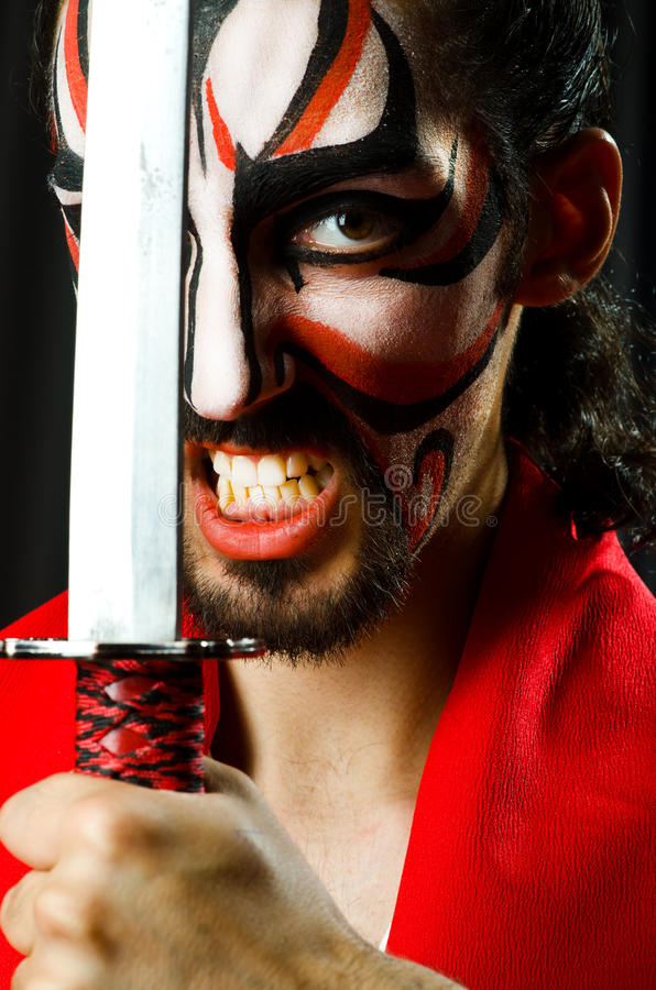 Man with sword. And face mask royalty free stock images