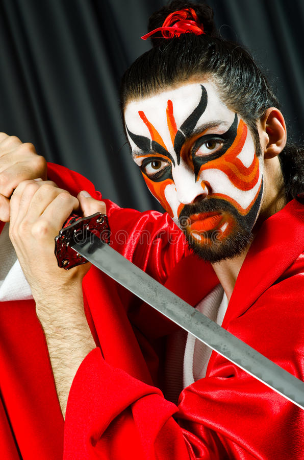 Man with sword. And face mask stock photo