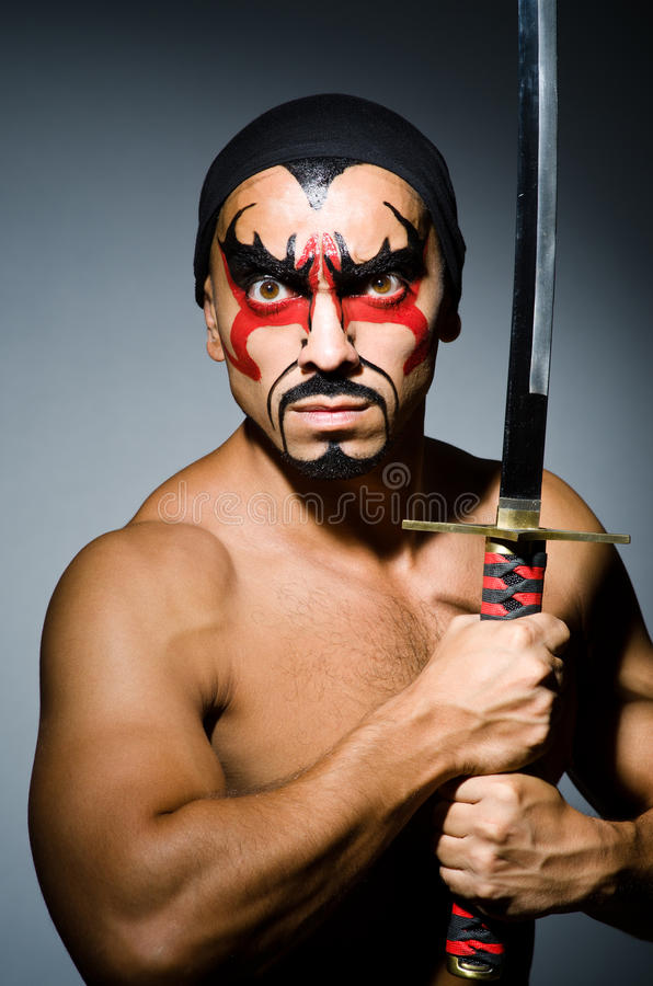 Man with sword. And face paint stock photos