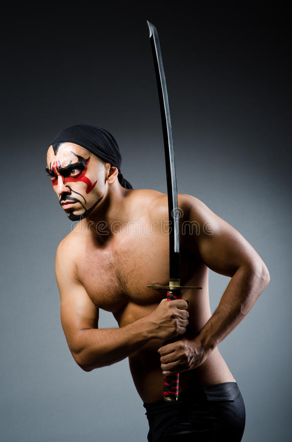 Man with sword. And face paint royalty free stock photos