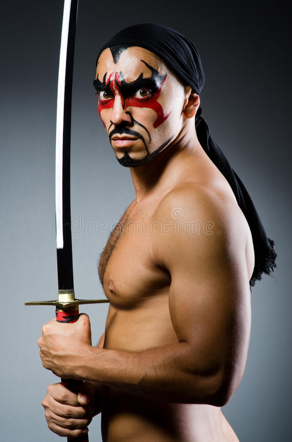 Man with sword. And face paint stock images
