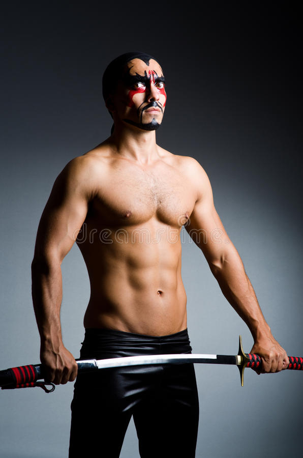 Man with sword. And face paint royalty free stock photography