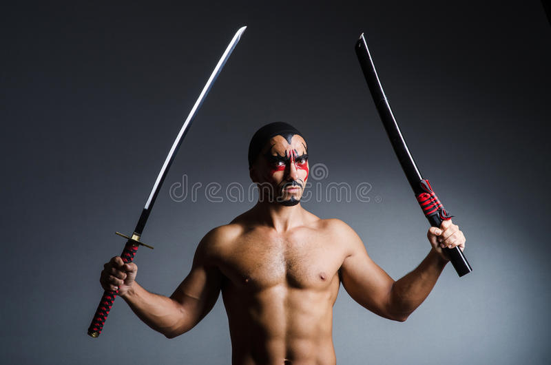 Man with sword. And face paint royalty free stock images
