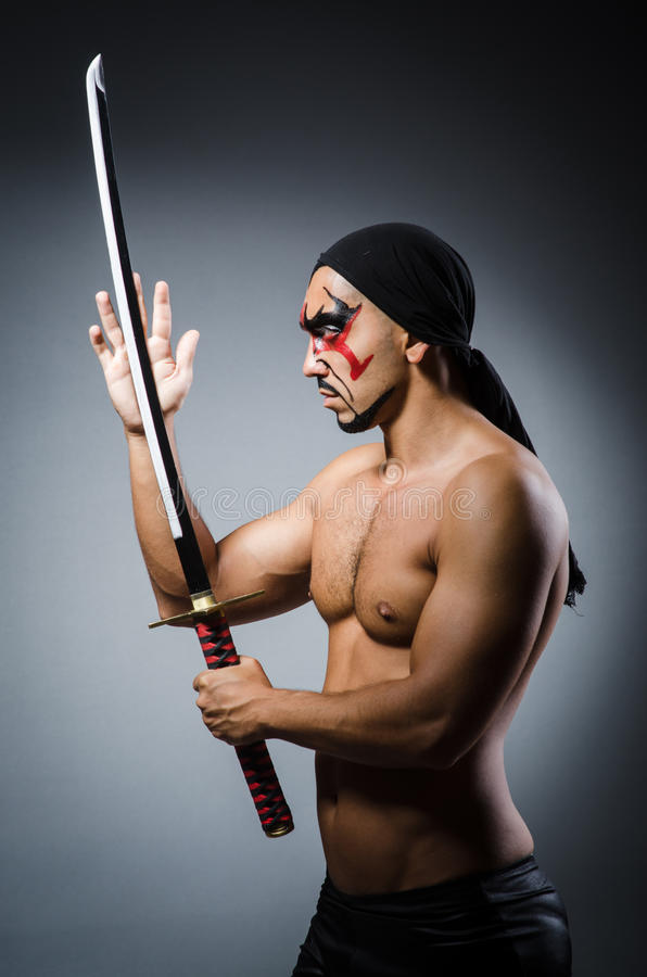 Man with sword. And face paint stock photography