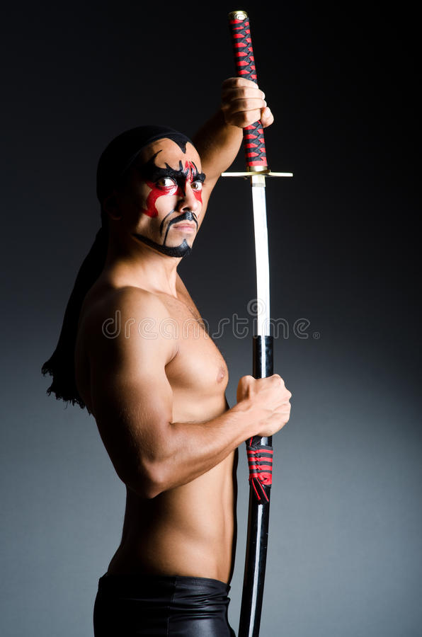 Man with sword. And face paint stock photo