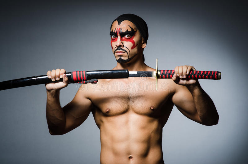 Man with sword. And face paint royalty free stock image