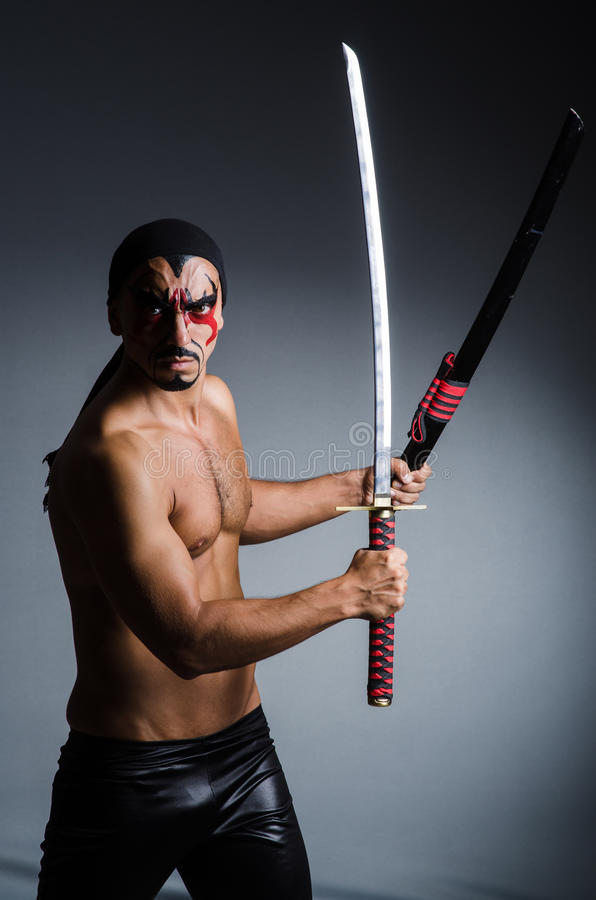 Man with sword. And face paint stock image