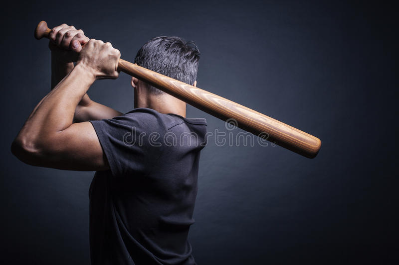 Man swung the bat stock images