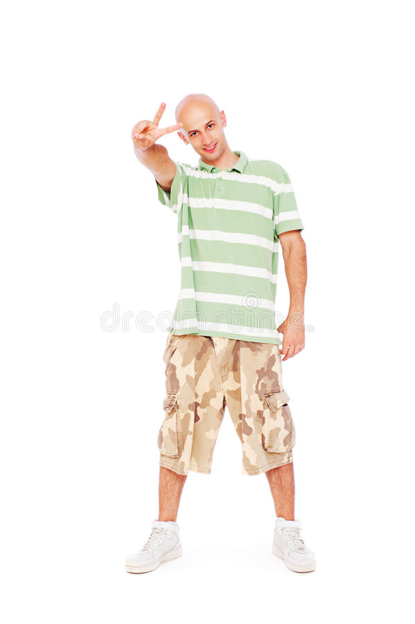 Man in t-shirt showing victory peace sign stock images