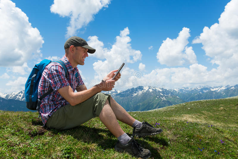 Man with tablet computer. Man working outdoors with tablet computer stock image