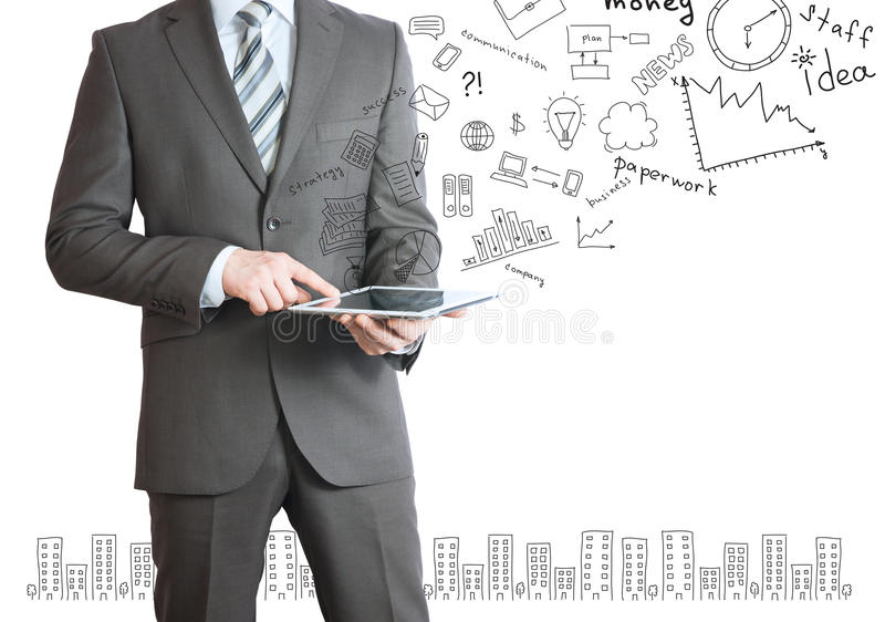 Man with tablet in hands and business sketches. Businessman with a tablet in hands and business sketches. Business concept stock images