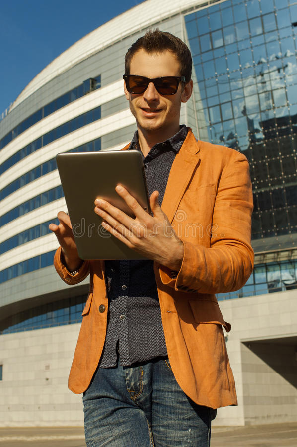 Man with the tablet in hands stock photography