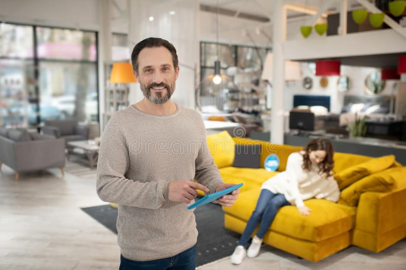 Man with tablet in his hands feeling good royalty free stock photo