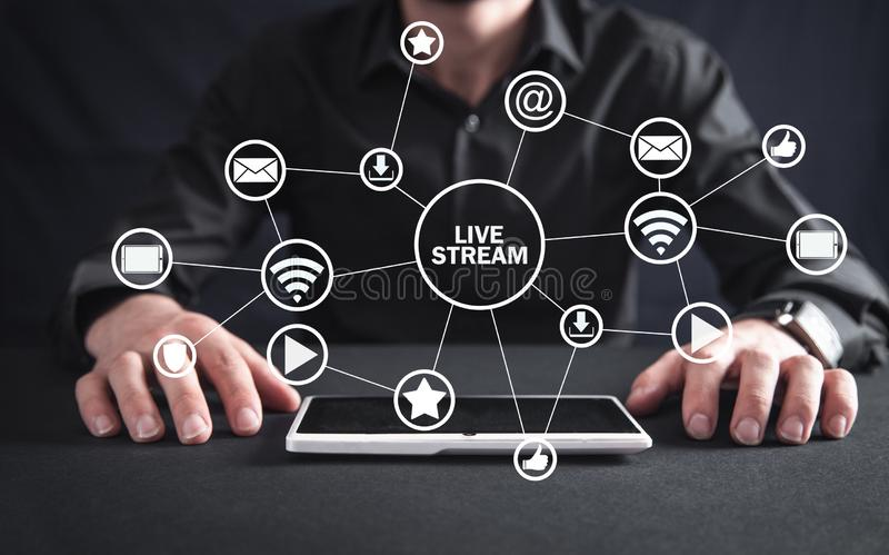 Man with tablet. Live stream concept stock photos