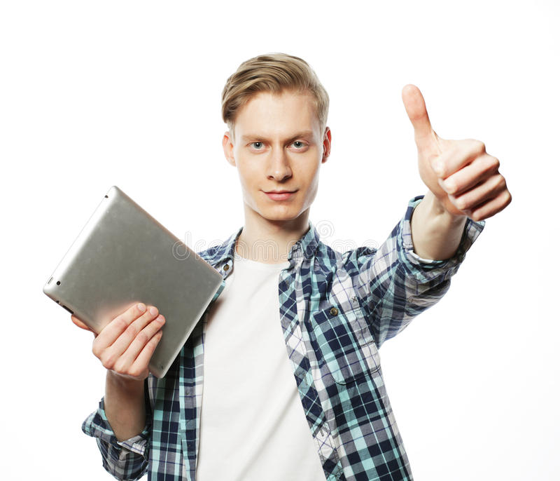 man with tablet pad computer making the ok thumbs up hand sign royalty free stock photo