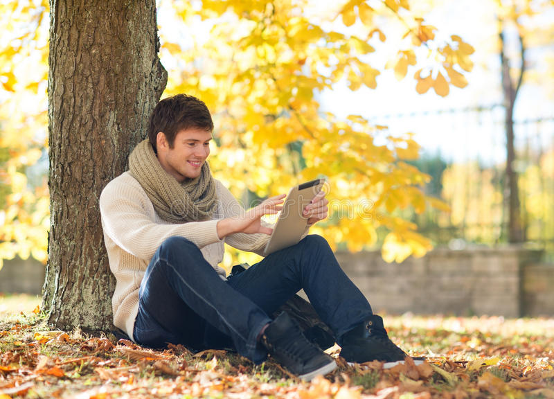 Download Man With Tablet Pc In Autumn Park Stock Photo - Image: 34772802