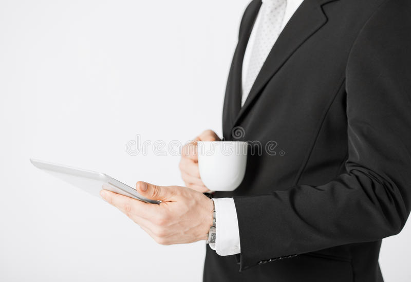 Download Man With Tablet Pc And Cup Of Coffee Stock Photo - Image: 32284542