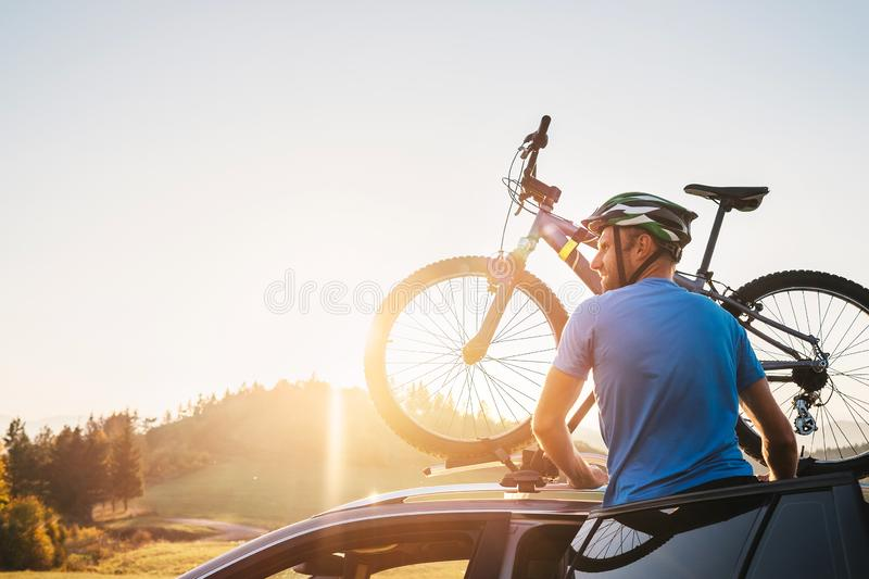 Man take his bicycle from car roof. Mountain biking concept royalty free stock photos