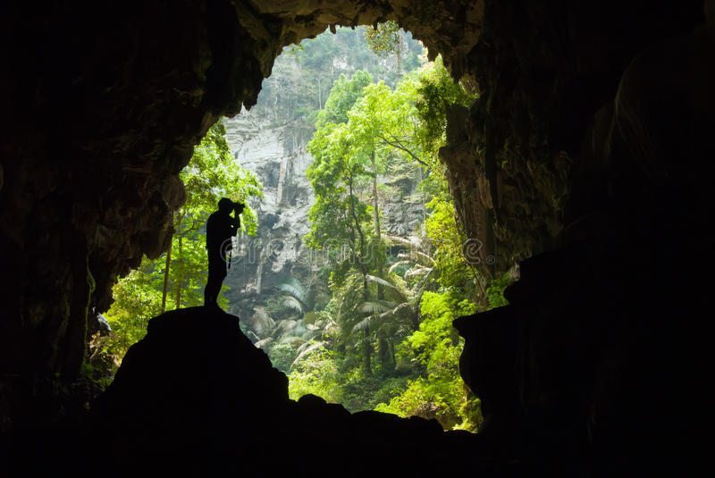 Man Inside A Cave Royalty Free Stock Photo