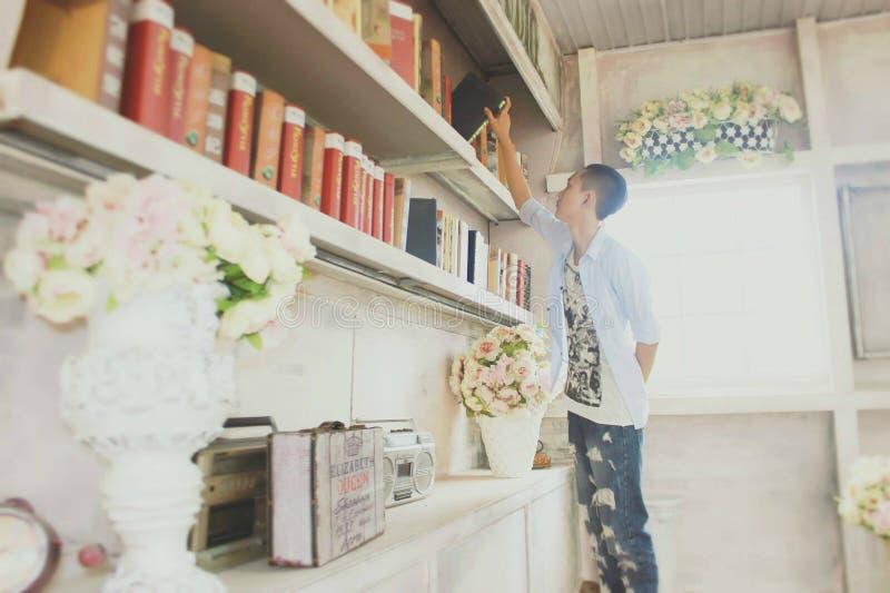 Man Takes Book Off Shelf Free Public Domain Cc0 Image