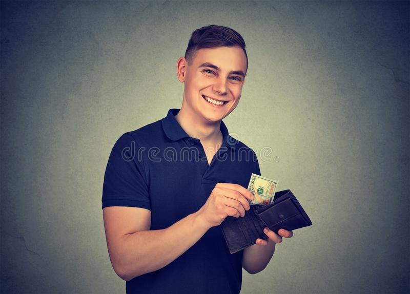 Man takes money out of wallet stock image