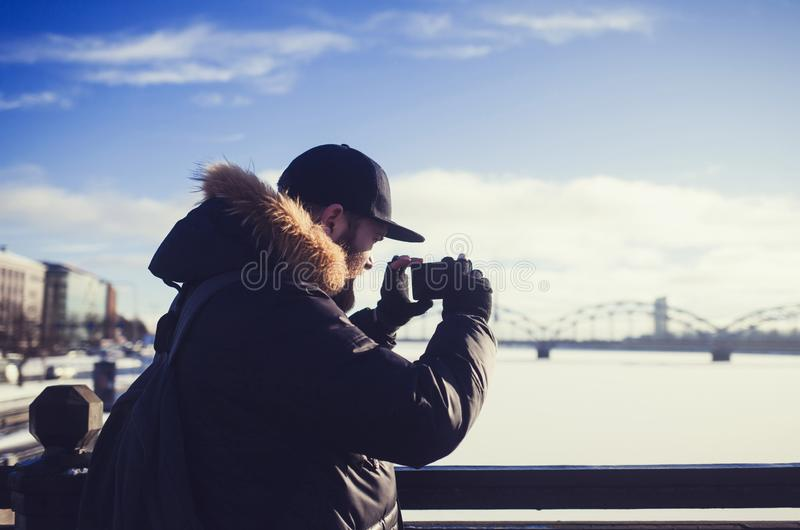 Man takes pictures on a smartphone stock photography